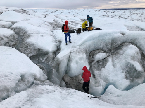 Researchers looking for methane in the air within crevices on the surface of the Greenland Ice Sheet.