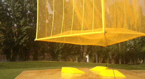 Outdoor work of art in yellow and orange colours